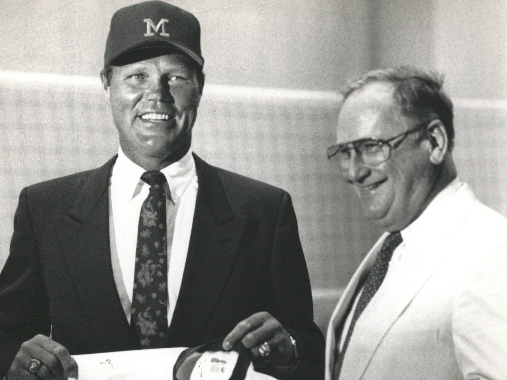 New Michigan baseball coach Bill Freehan holds the No.11 jersey - the number he wore when he at U-M - he received from athletic directer Bo Schembechler on Aug. 15, 1989.