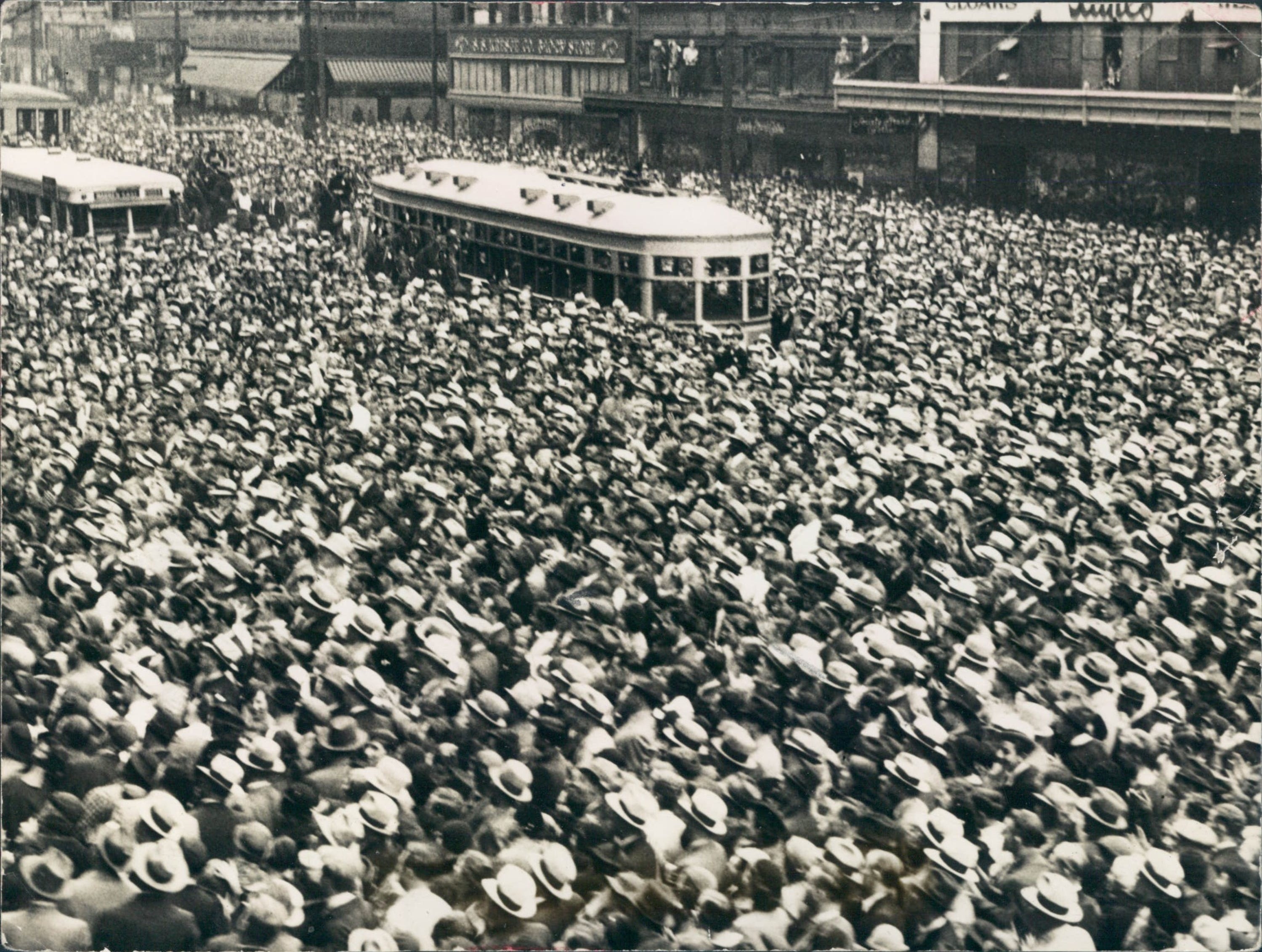 Detroiter's pack Woodward Ave in front of Hudson's to celebrate the 1934 Tigers American League pennant victory.