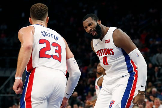 Detroit Pistons center Andre Drummond, right, reacts after a basket by forward Blake Griffin during the first half of their game against the Philadelphia 76ers on Oct. 23, 2018, in Detroit.