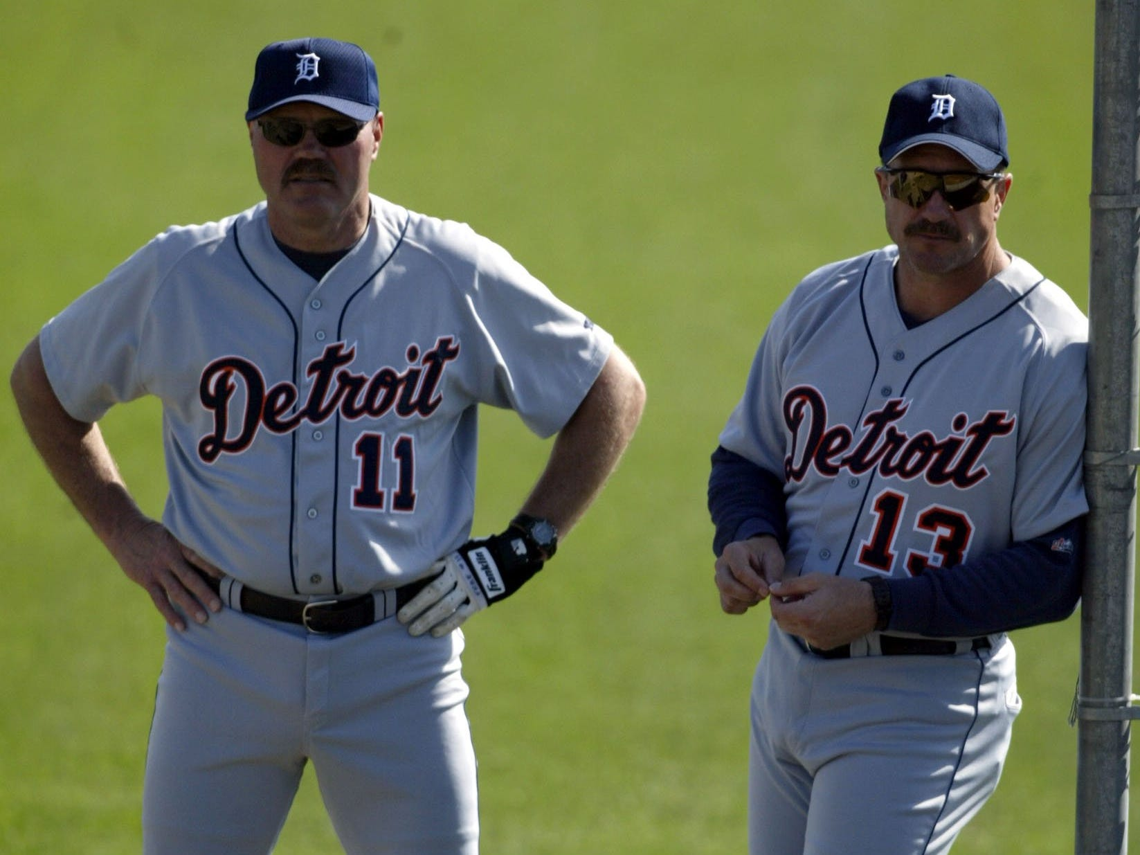 Former Tigers catchers Bill Freehan, left, and Lance Parrish, right, watch pitchers warmup during the morning workout at the Tigers spring training complex in Lakeland, Fla., on Saturday, Feb. 15, 2003.