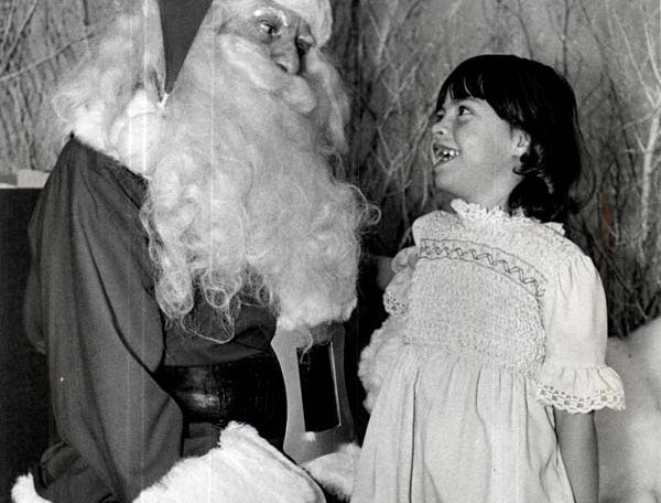 A little girl tells Santa what she wants for Christmas at the downtown Hudson's store.
