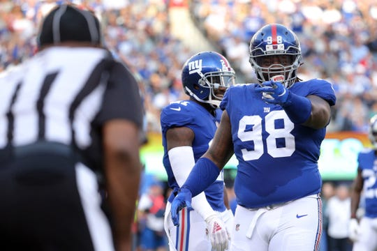 New York Giants defensive tackle Damon Harrison (98) points at side judge Boris Cheek (41) after a personal foul was called on cornerback Janoris Jenkins (not pictured) during the second quarter against New Orleans Saints at MetLife Stadium.