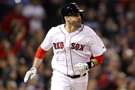 J.D. Martinez of the Boston Red Sox hits an RBI double during the third inning against the Los Angeles Dodgers in Game 1 of the 2018 World Series at Fenway Park on October 23, in Boston.