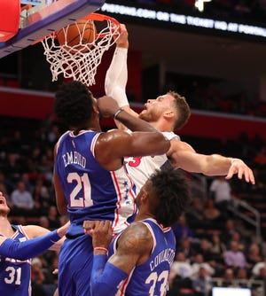 Detroit Pistons forward Blake Griffin dunks against Philadelphia center Joel Embiid during the second period Tuesday, Oct. 23, 2018 at Little Caesars Arena in Detroit.