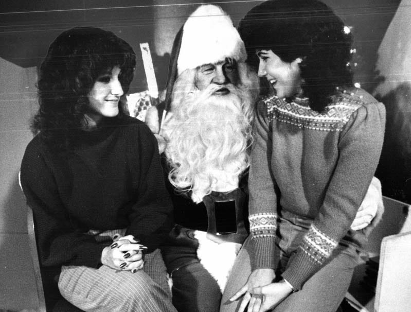 Two women tell Santa what they want for Christmas at Hudson's in downtown Detroit on Dec. 23, 1982.