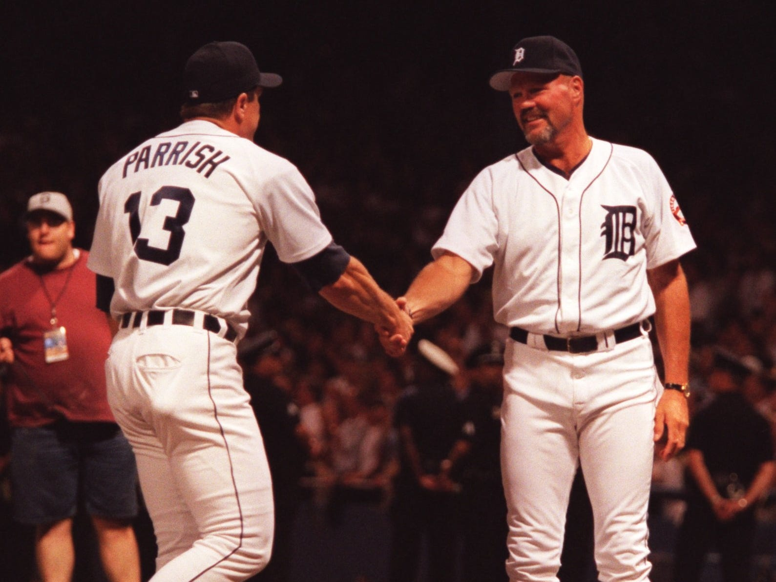 Former Detroit Tiger catchers Lance Parrish, left, and Bill Freehan shake hands during the closing ceremony after the final game at Tiger Stadium on Sept. 27, 1999.