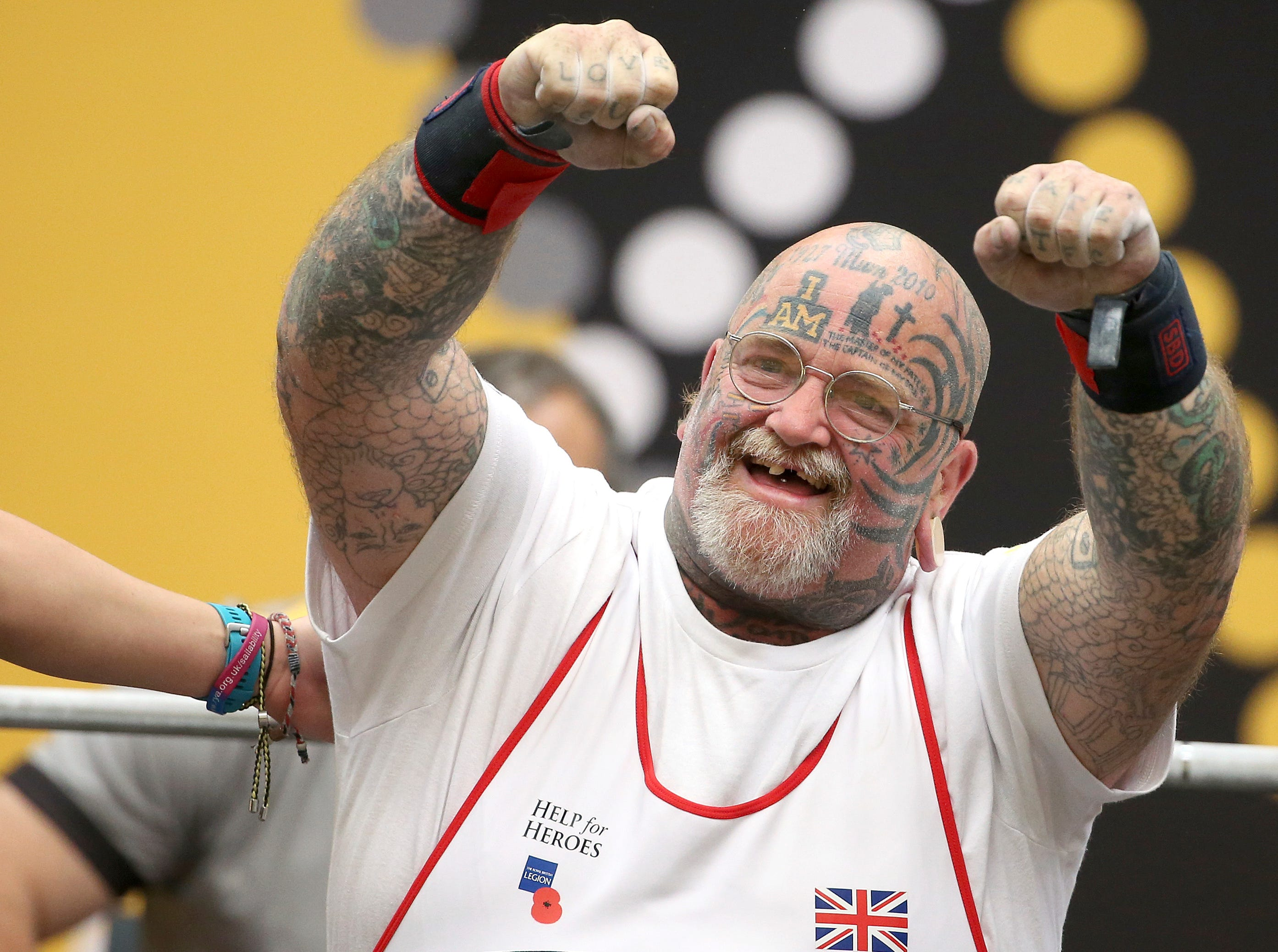 Britain's Paul Guest celebrates after a successful lift during the powerlifting competition at the Invictus Games in Sydney, Wednesday, Oct. 24, 2018.