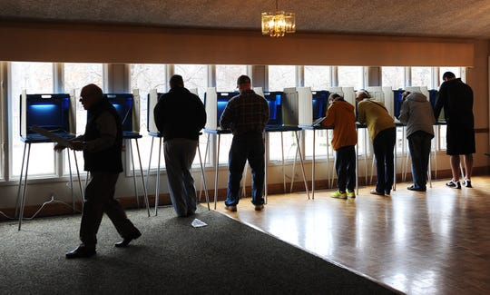 Voters line up to cast their ballots at the Rochester Community House on November 4, 2014.