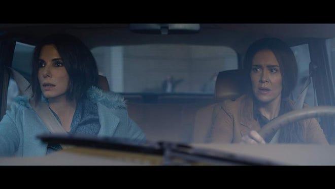 "Sandra Bullock, left, and Sarah Paulson star in the post-apocalyptic ""Bird Box."""