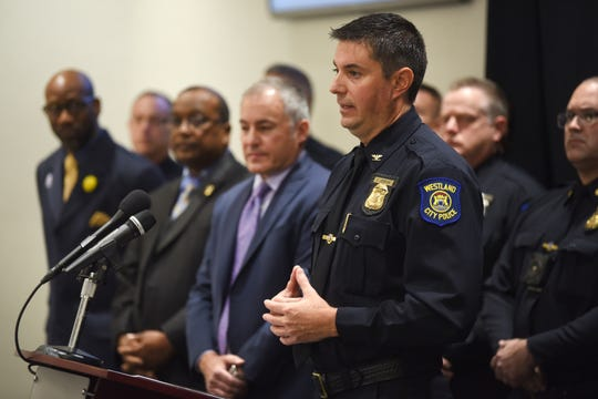 Westland Police Chief Jeff Jedrusik (right) announced at a news conference that the department will deploy body cameras to all patrol officers.
