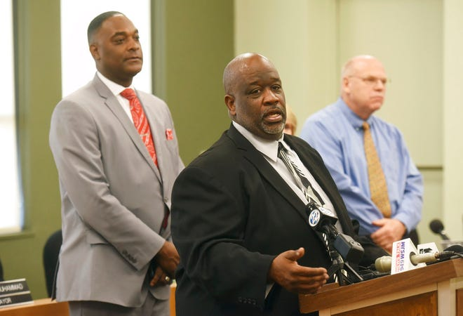 From left, Benton Harbor Mayor Marcus Muhammad, Benton Harbor City Manager Darwin Watson and Berrien County Medical Director Dr. Rick Johansen hold a press conference Wednesday, Oct. 24, 2018, at City Hall in Benton Harbor, Mich., to let the public know thatthe city's water system is under a state advisory for lead after summer sampling revealed higher-than-acceptable levels.