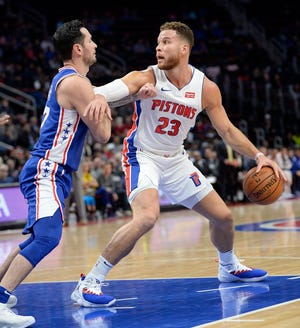 Pistons' Blake Griffin looks for room around 76ers' JJ Redick. Griffin finished with 50 points, including the winning three-point play.
