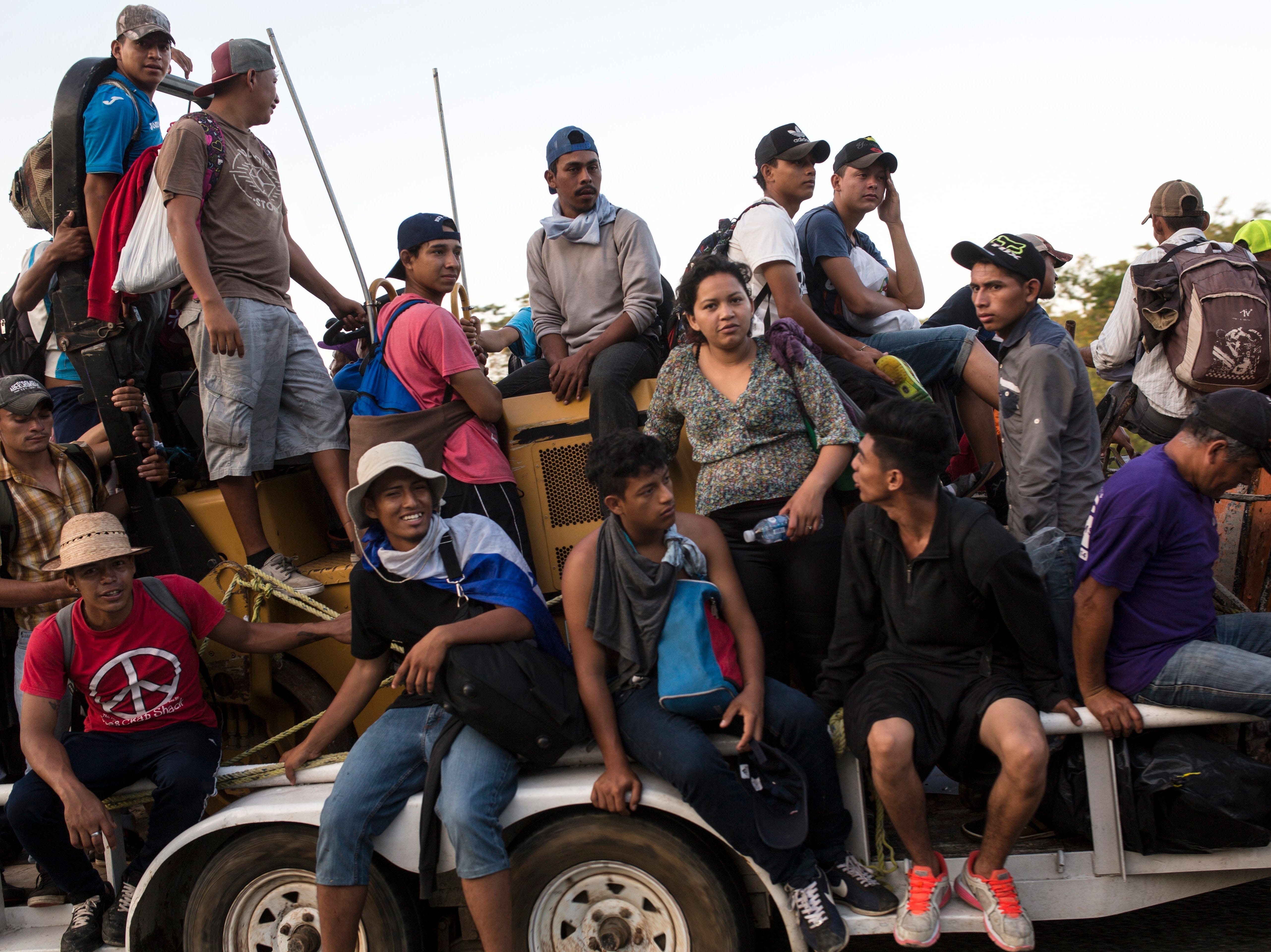 Central American migrants traveling with a caravan to the U.S. crowd onto a tractor as they make their way to Mapastepec, Mexico, Wednesday, Oct. 24, 2018. Thousands of Central American migrants renewed their hoped-for march to the United States on Wednesday, setting out before dawn with plans to travel another 45 miles (75 kilometers) of the more than 1,000 miles that still lie before them.