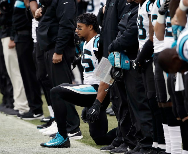 Panthers strong safety Eric Reid, center, had his grievance against the Bengals denied by an arbitrator, a decision that has irked the NFL Players Association.