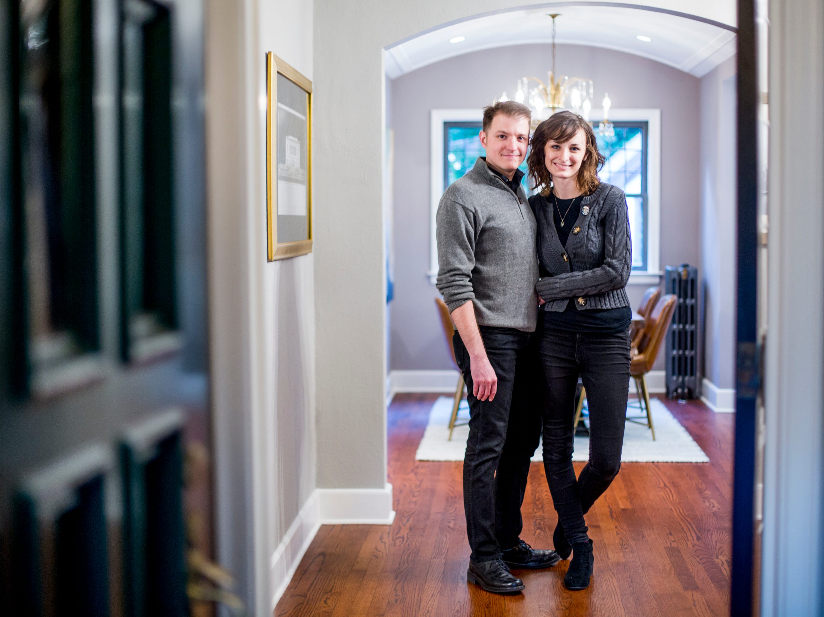 Miranda Steinhauser, poses for a photo with her partner Brandon Suman, in her home at 17405 Wildemere Street in the University District in Detroit.