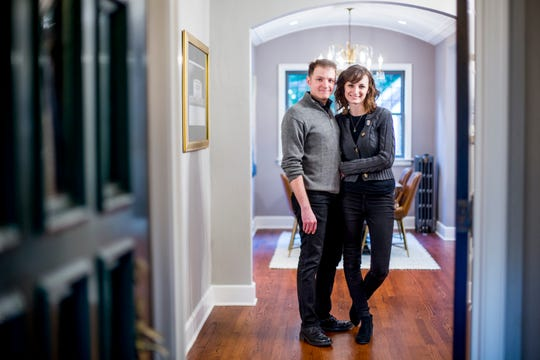 Miranda Steinhauser, poses for a photo with her partner, Brandon Suman, in her home at 17405 Wildemere Street in the University District in Detroit.