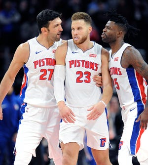 The Pistons' Zaza Pachulia and Reggie Bullock celebrate with Blake Griffin after he completed a three-point play to give the Pistons a one-point lead with 1.8 second left in the game. Griffin had a career high 50 points, The Pistons defeated the 76ers 133-132 in OT, Tuesday, October 23, 2018 at Little Caesars Arena in Detroit, Michigan.