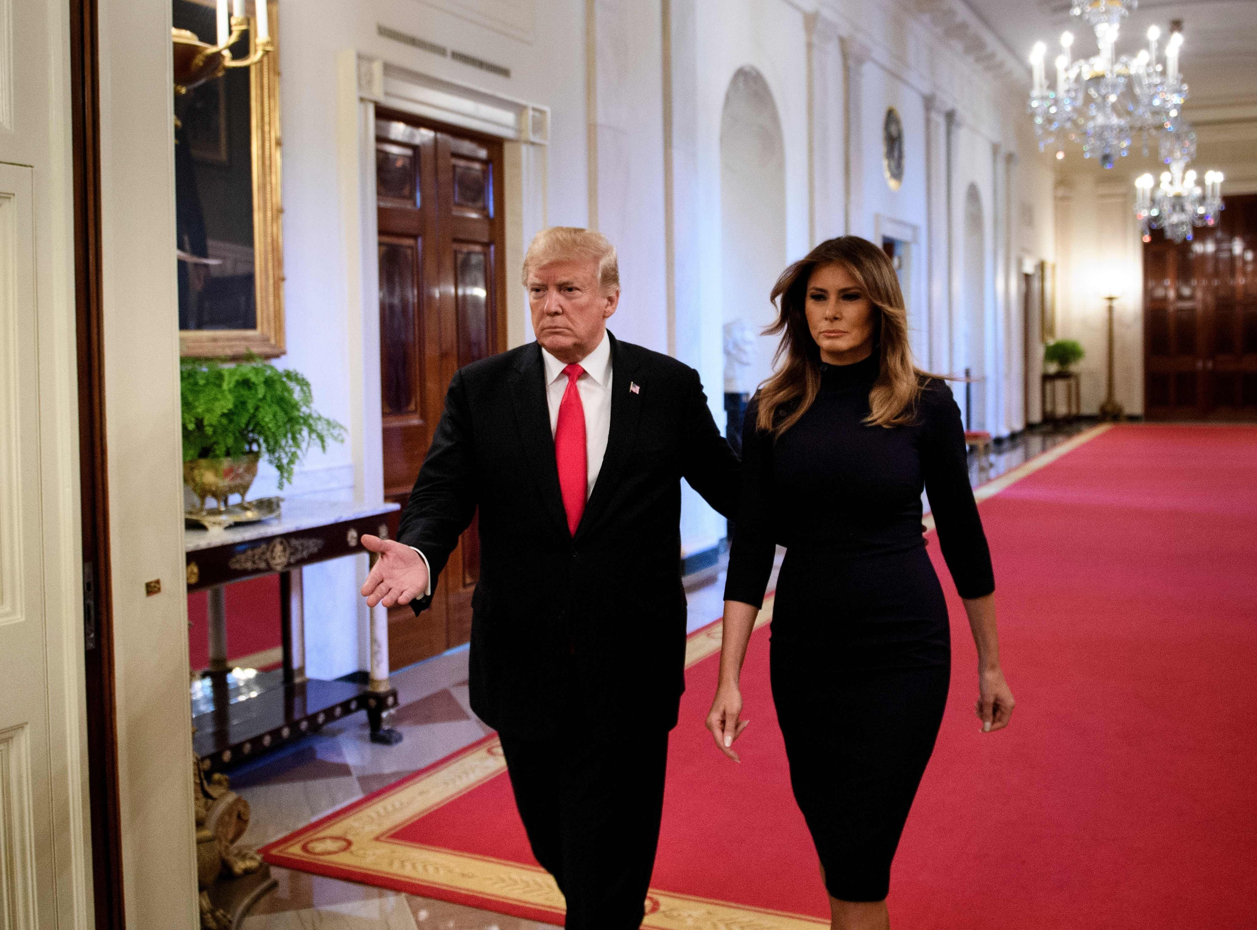US President Donald Trump and US First Lady Melania Trump arrive for an event on a year of progress and action to combat the opioid crisis, in the East Room of the White House on October 24, 2018 in Washington, DC.