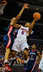 Evansville's Troy Taylor (5) goes up for a shot as Southern Indiana's Austin Davis (20) blocks his shot in the first half of their exhibition game at the Ford Center, Saturday night, Oct. 27, 2012.