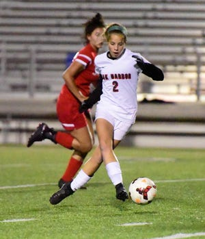 Oak Harbor's Hannah Schulte controls the ball against Toledo Central Catholic. Schulte scored 21 goals this season.