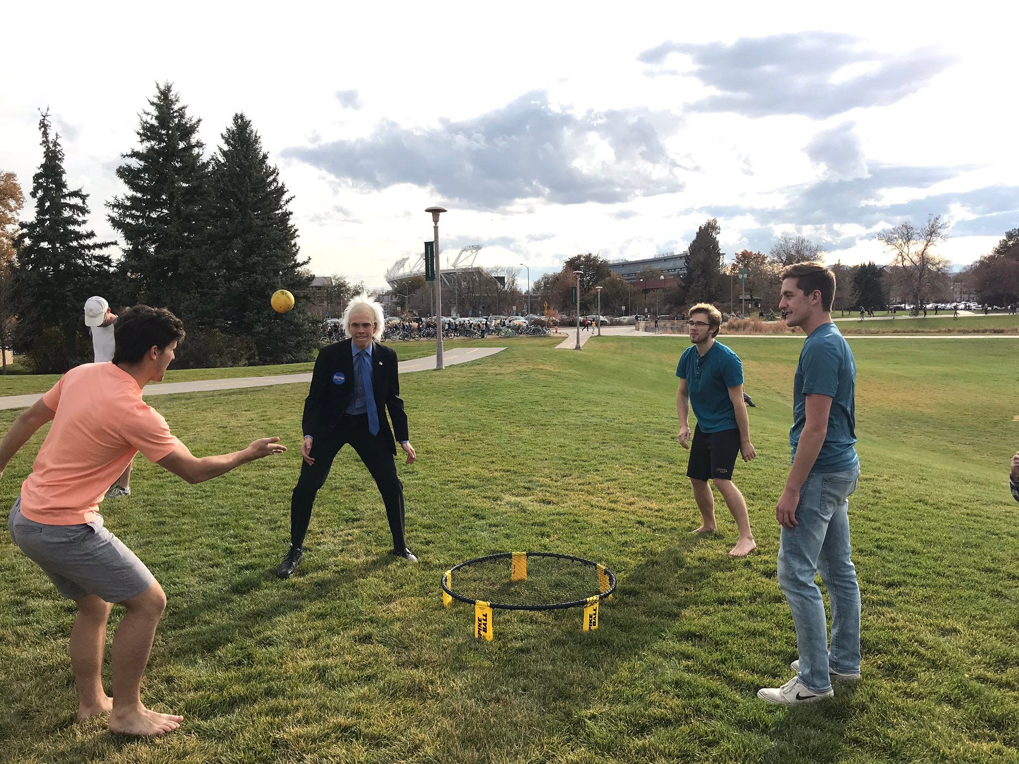 A person dressed like Sen. Bernie Sanders plays a game of pike ball with others on the CSU campus Wednesday, the day of a political rally featuring the senator.