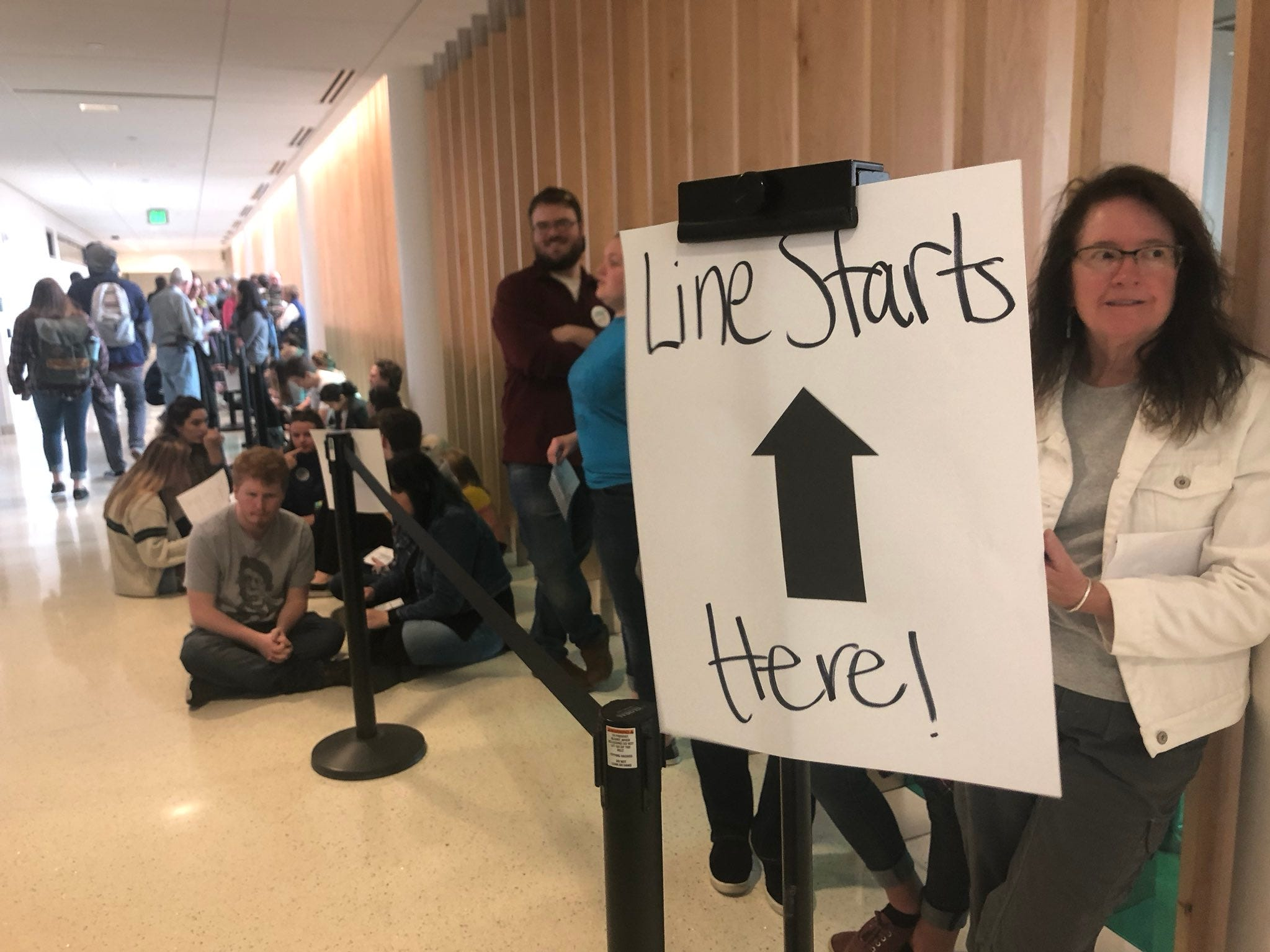 A line of people wait to get into the rally featuring Sen. Bernie Sanders, governor candidate Rep. Jared Polis, congressional candidate Joe Neguse and Sen. Michael Bennet.