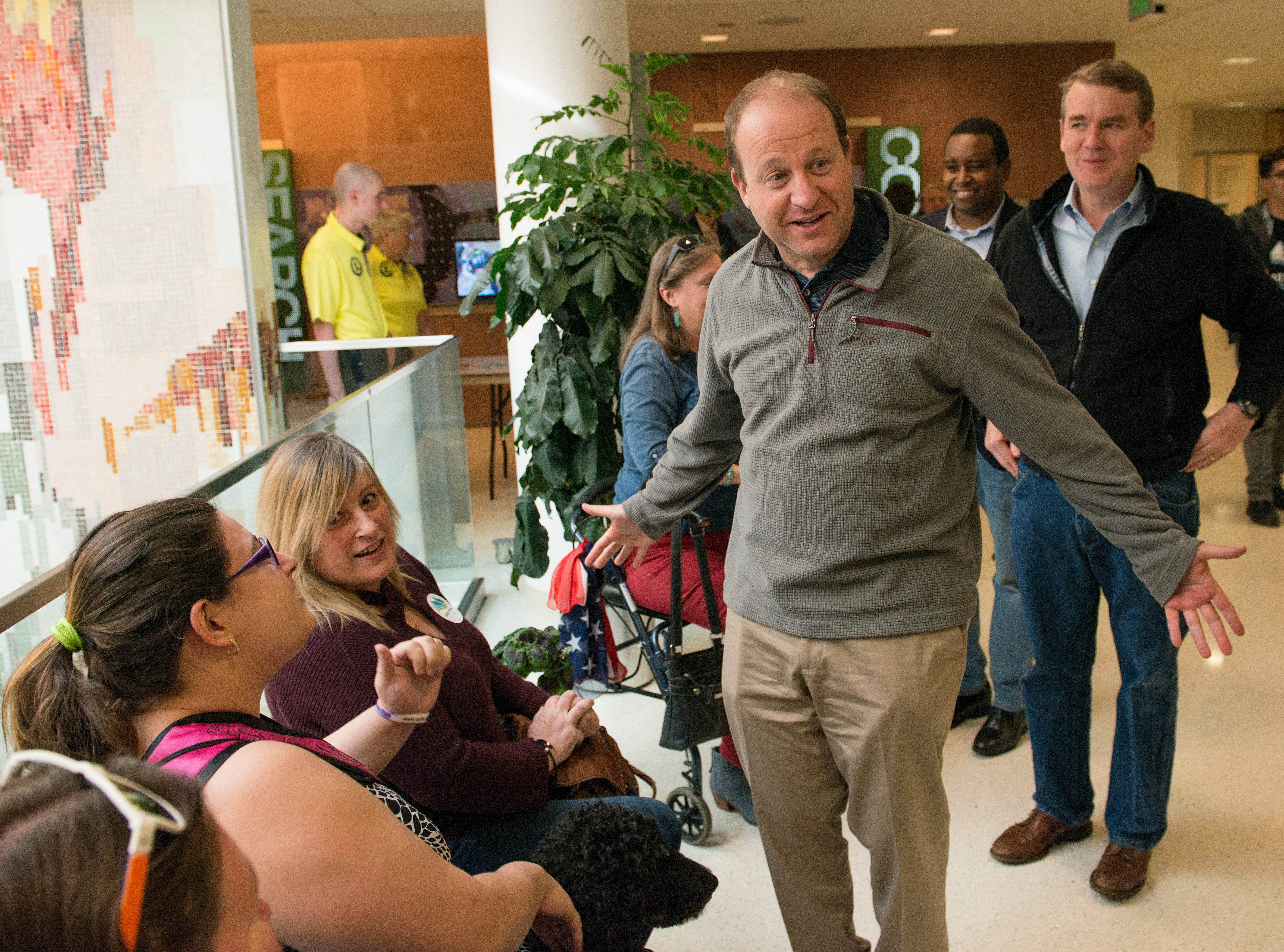 Democratic candidate for Colorado Governor greets supporters as he arrives at a Colorado Democrats rally with U.S. Sen. Michael Bennett and congressional candidate Joe Neguse at the Lory Student Center at CSU on Wednesday, October 24, 2018.