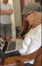 "Barbara Lueck, 76, watches a video made by her former students. About 50 alumni got together to sing ""Seasons of Love"" for her when they learned she was battling cancer."
