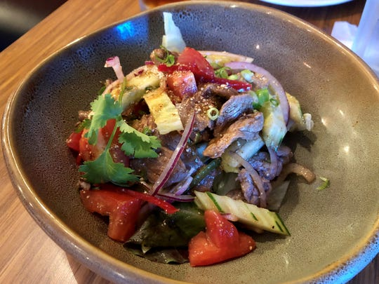 Bangkok Thai's spicy beef salad is served in a chili-lemon dressing with a dash of fish sauce for a fermented and salty finish.
