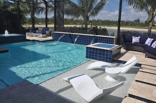 The pool has a sun shelf and spa. Beside the pool is a fire pit and an additional sitting area.