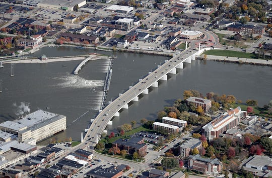 The Claude Allouez Bridge crosses the Fox River in De Pere in October 2018. St. Norbert College is at lower right.