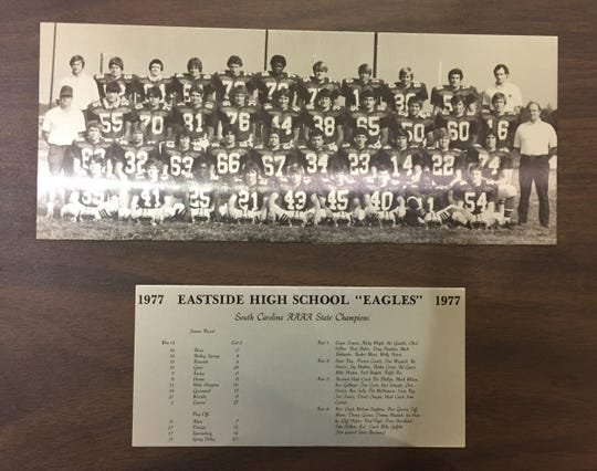 A plaque celebrating Eastside's 1977 state championship team features a photo of the Eagles and the results from the season.