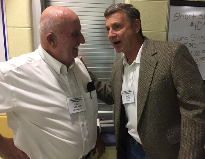 Former Eastside football coach John Carlisle, left, shares a memory with Brad Baker, a member of the Eagles' 1977 championship team, during a reunion Oct. 12 at the high school.