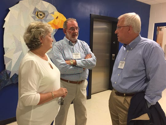 Billy Griffith, center, an assistant coach during the 1977 Eastside football championship season, and wife Della chat with David Charpia, the team's quarterback, during a reunion at the school Oct. 12.