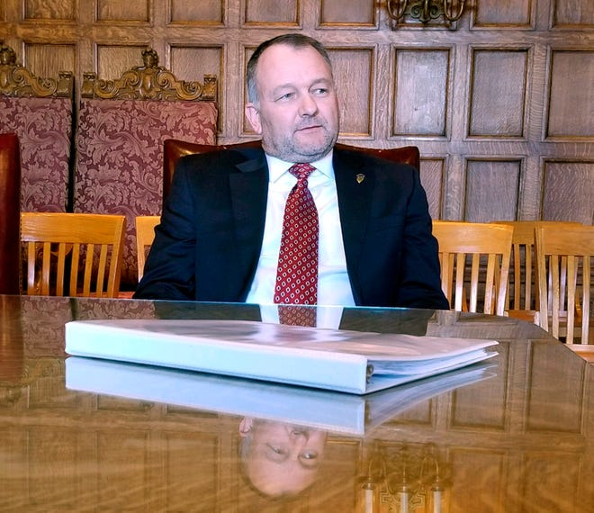 New Yellowstone National Park Superintendent Cam Sholly speads during a meeting with Montana Gov. Steve Bullock at the state Capitol in Helena, Mont., Tuesday, Oct. 23, 2018. Sholly says he will not consider capping the number of visitors to the nation's first national park, but would consider looking at ways to reduce traffic. (AP Photo/Amy Beth Hanson)