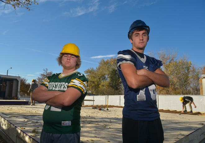 CMR's William Harr and Great Falls High's Daunte Janikula work together on the High School House construction project.  They will face off this week in the crosstown football game.
