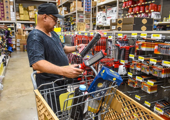 Inarajan resident Mel Duenas shops for lighting equipment at the Guam Home Center in Dededo, in preparation for the approach of Typhoon Yutu on Wednesday, Oct. 24, 2018. Duenas looked over the option of rechargeable handheld lights but he also planned to purchase oil-fueled lamp in case power remained off for an extended period of time.