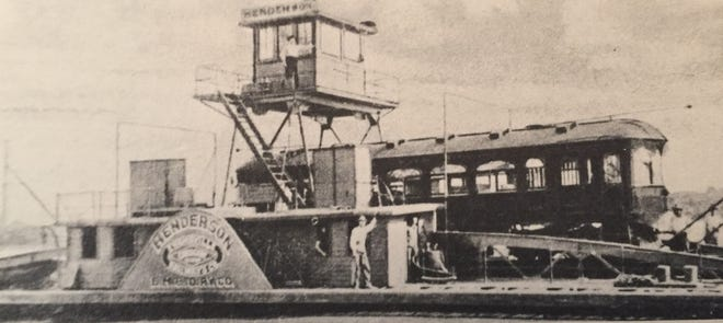 """A 1915 photo of the interurban ferry that crossed the Ohio River where the Twin Bridges now stand. The ferry was the only one of its type on the Ohio River. This photo, which is from the archives of the St. Louis Public Library, appears in Norbury L. Wayman's 1971 book, """"Life on the River."""""""