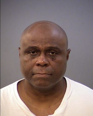 Troy Fitts, 54, was arrested on charges of domestic battery and battery, IMPD said.