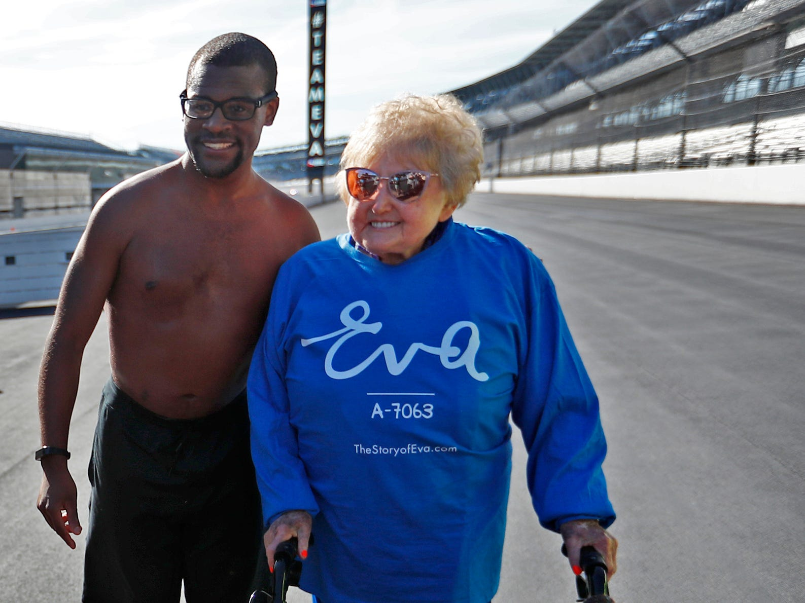 Andrew Peterson, left, poses with Holocaust survivor Eva Kor at the Indianapolis Motor Speedway Yard of Bricks, Wednesday, Oct. 24, 2018, midway during the pace-setting run for the 2019 OneAmerica 500 Festival Mini-Marathon.  The 500 Festival will donate $1 to the CANDLES Holocaust Museum in Terre Haute for every mini-marathon participant who finishes the 2019 race in a better time than Team Eva.  Peterson was one of the runners and Korn did the last short leg of the race.