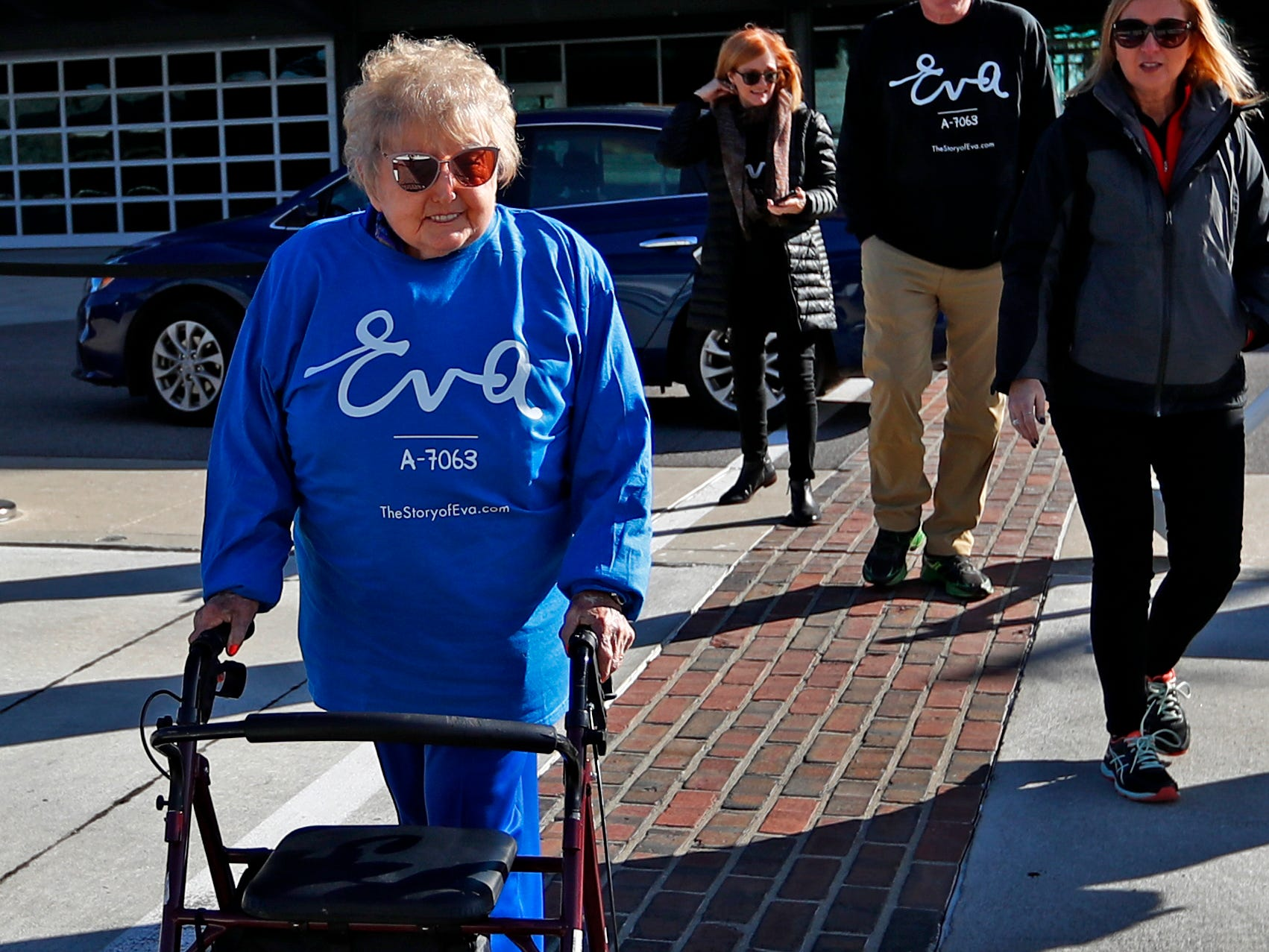 Holocaust survivor Eva Kor walks on the Indianapolis Motor Speedway bricks to get ready to welcome runners and pose for photos, Wednesday, Oct. 24, 2018, during the pace-setting run for the 2019 OneAmerica 500 Festival Mini-Marathon.  The 500 Festival will donate $1 to the CANDLES Holocaust Museum in Terre Haute for every mini-marathon participant who finishes the 2019 race in a better time than Team Eva.  Kor ran the very last of the relay race.