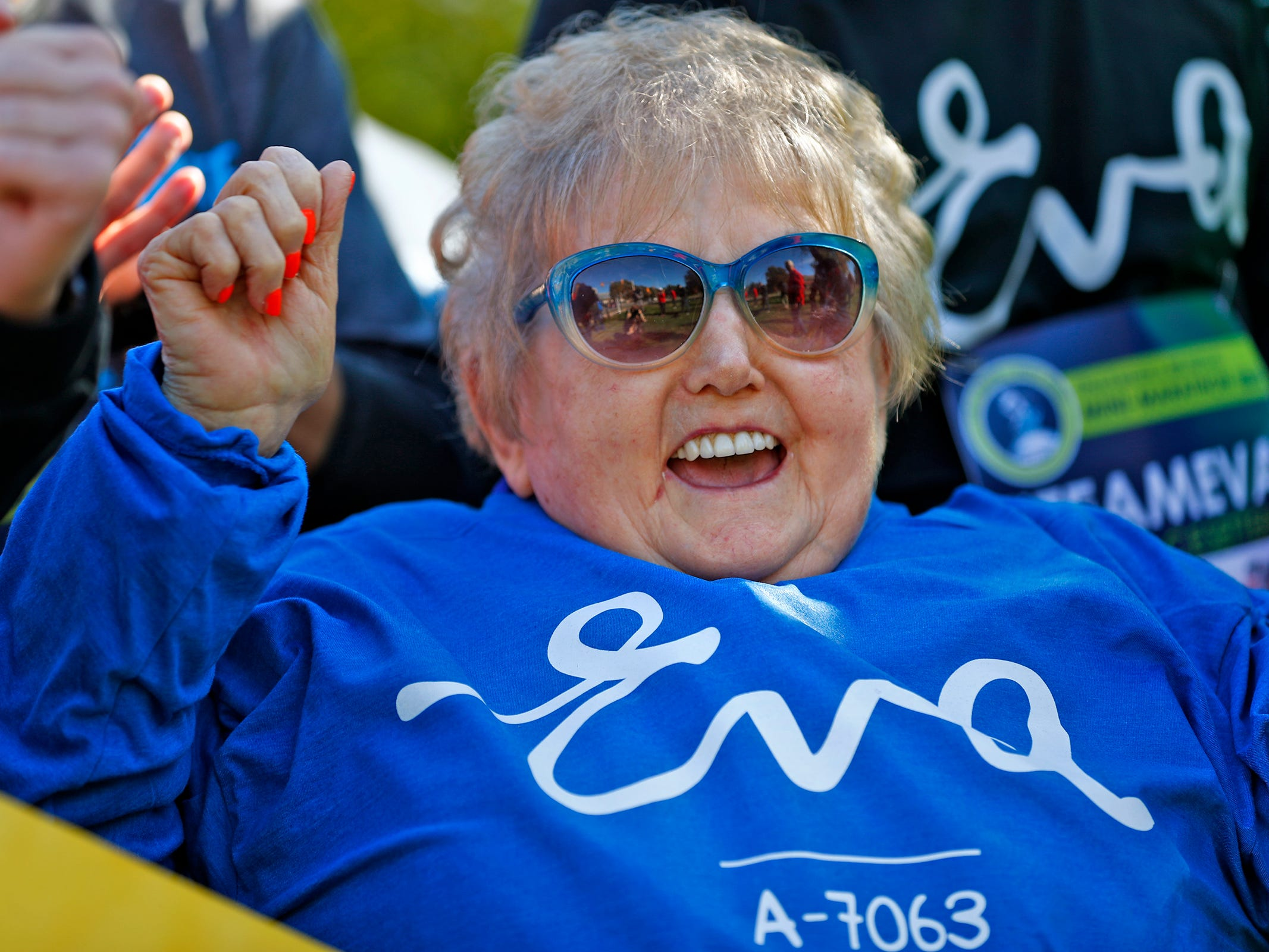 Holocaust survivor Eva Kor cheers and joins others at the end, Wednesday, Oct. 24, 2018, of the pace-setting run for the 2019 OneAmerica 500 Festival Mini-Marathon.  The 500 Festival will donate $1 to the CANDLES Holocaust Museum in Terre Haute for every mini-marathon participant who finishes the 2019 race in a better time than Team Eva, which was 2 hours, 7 minutes, 36 seconds.  Kor ran the very last part of the relay race to add to the time.