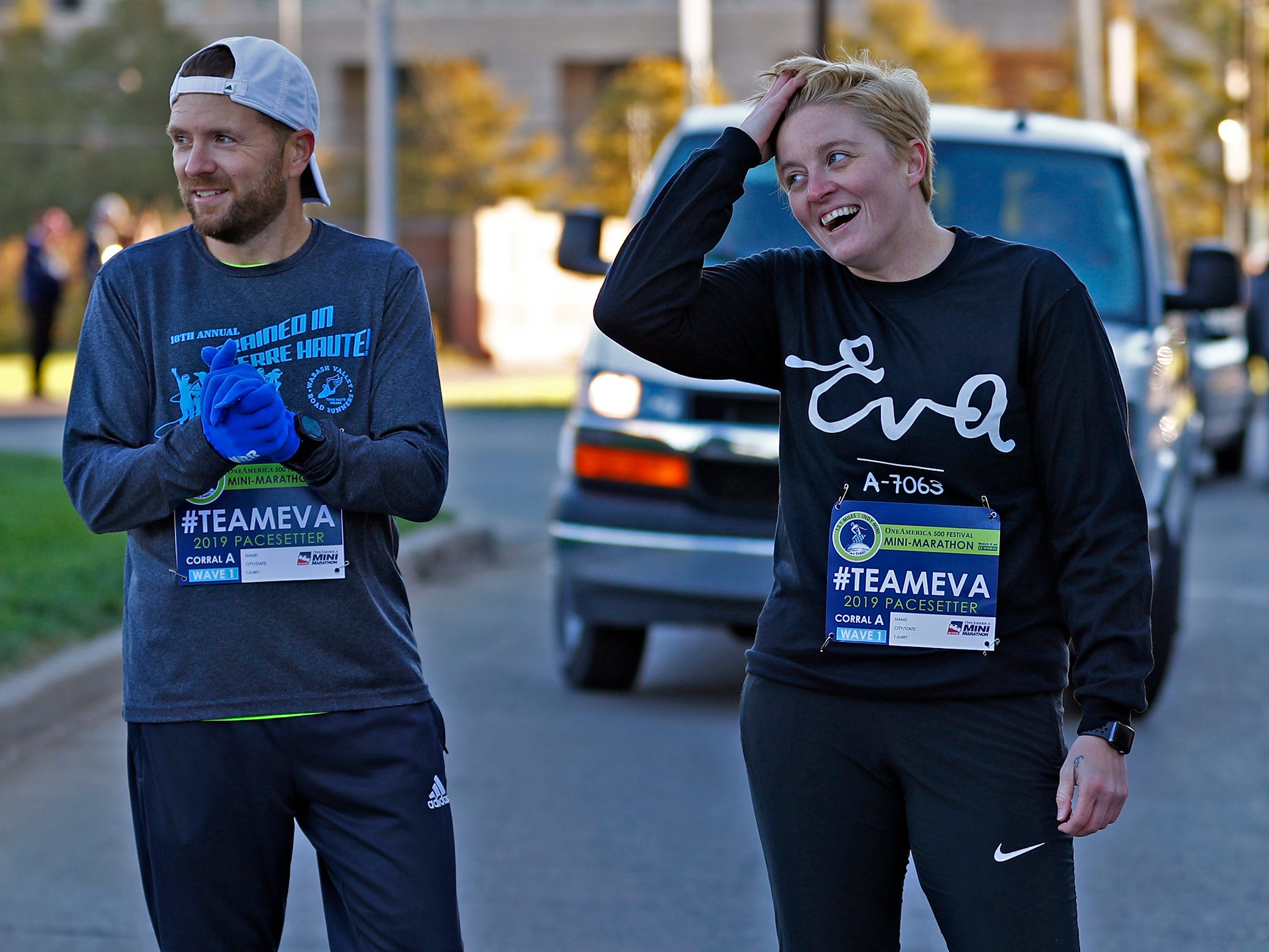 Brad Chaney, left, and Mika Brown wait to run the first leg, Wednesday, Oct. 24, 2018, of the pace-setting run for the 2019 OneAmerica 500 Festival Mini-Marathon.  The 500 Festival will donate $1 to the CANDLES Holocaust Museum in Terre Haute for every mini-marathon participant who finishes the 2019 race in a better time than Team Eva.  Holocaust survivor Eva Kor joined the fun at the Indianapolis Motor Speedway's Yard of Bricks and ran the very last part of the race.