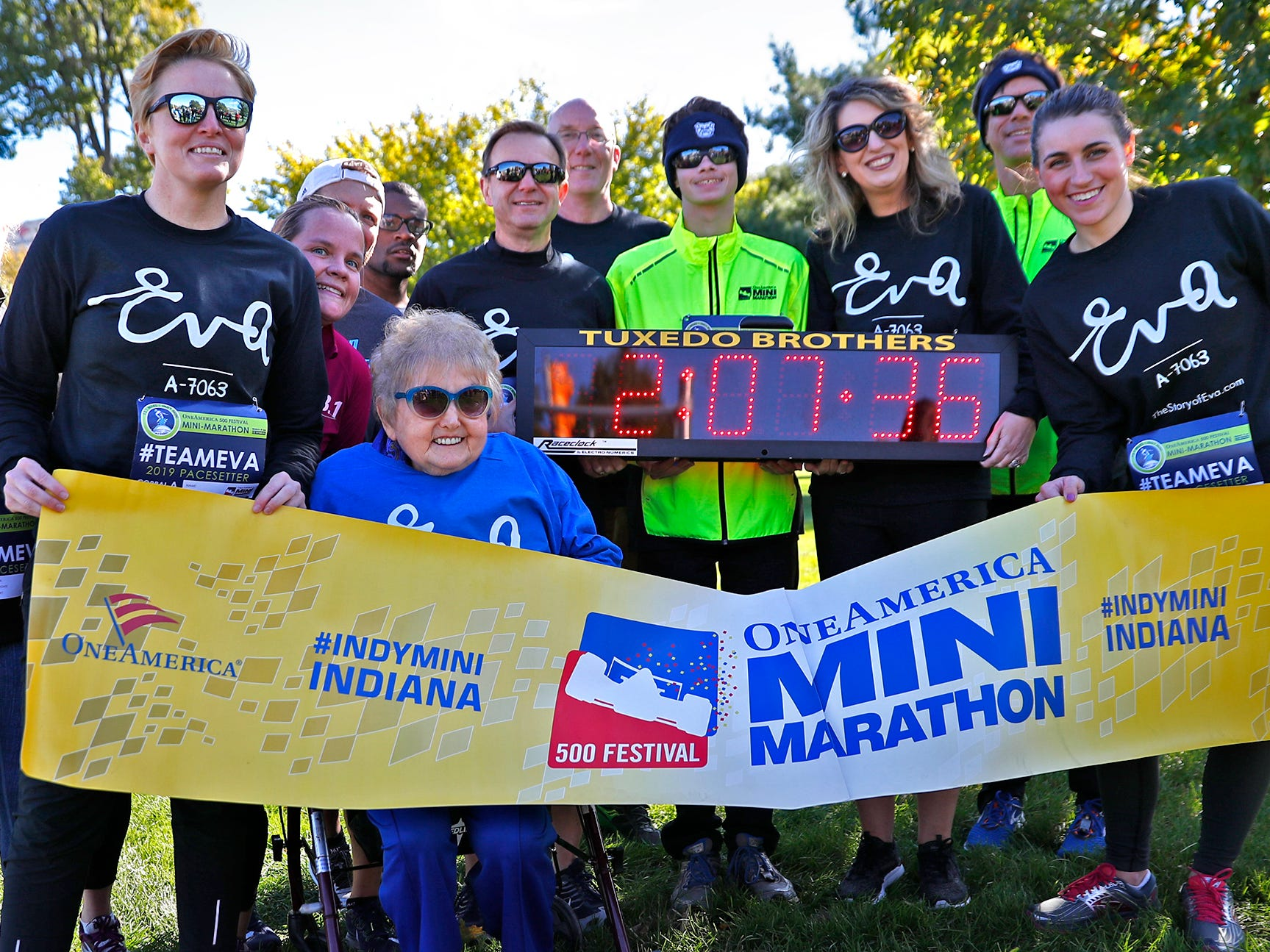Holocaust survivor Eva Kor joins others for a photo after the relay running of the pace-setting run for the 2019 OneAmerica 500 Festival Mini-Marathon, Wednesday, Oct. 24, 2018.  The 500 Festival will donate $1 to the CANDLES Holocaust Museum in Terre Haute for every mini-marathon participant who finishes the 2019 race in a better time than Team Eva, which was 2 hours, 7 minutes, 36 seconds.  Kor ran the very last part of the relay race to add to the time.