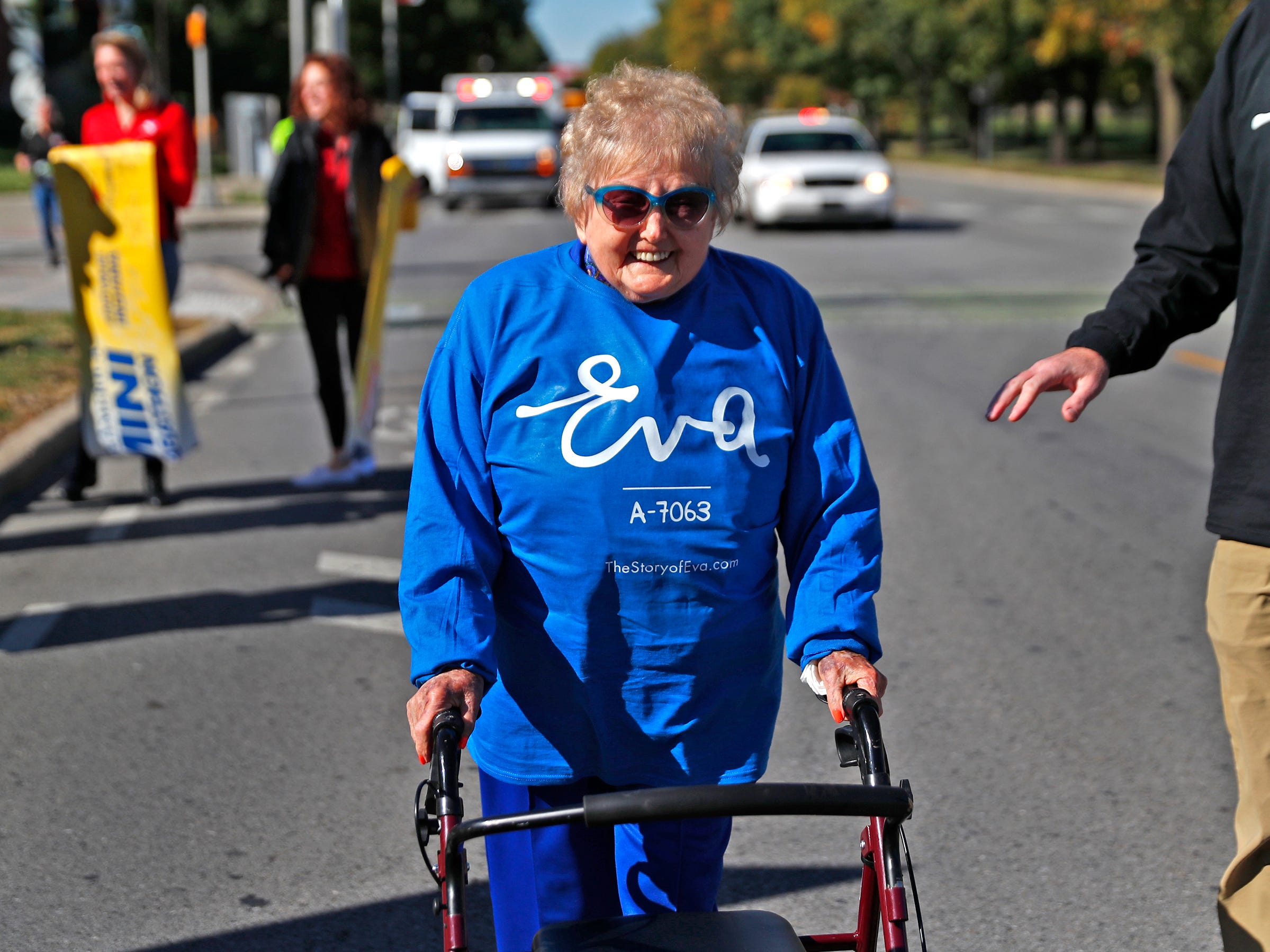 Holocaust survivor Eva Kor smiles after finishing the end leg of the pace-setting run for the 2019 OneAmerica 500 Festival Mini-Marathon, Wednesday, Oct. 24, 2018.  The 500 Festival will donate $1 to the CANDLES Holocaust Museum in Terre Haute for every mini-marathon participant who finishes the 2019 race in a better time than Team Eva, which was 2 hours, 7 minutes, 36 seconds.