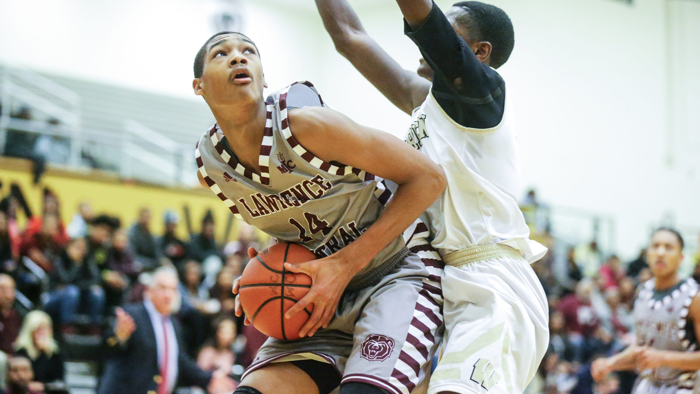 Lawrence Central's D'Andre Davis boxes out against Jesse Bingham (11) during a Marion County Basketball Tournament game at Warren Central High School on Tuesday, Jan. 9, 2018.