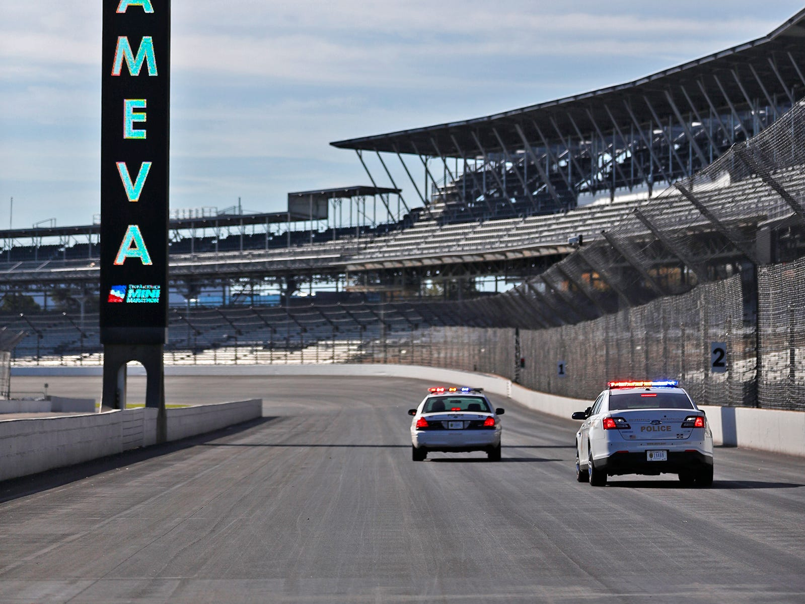 The Indianapolis Motor Speedway pylon touts Team Eva, Wednesday, Oct. 24, 2018, during the pace-setting run for the 2019 OneAmerica 500 Festival Mini-Marathon.  The 500 Festival will donate $1 to the CANDLES Holocaust Museum in Terre Haute for every mini-marathon participant who finishes the 2019 race in a better time than Team Eva.  Holocaust survivor Eva Kor ran the very last of the relay race.