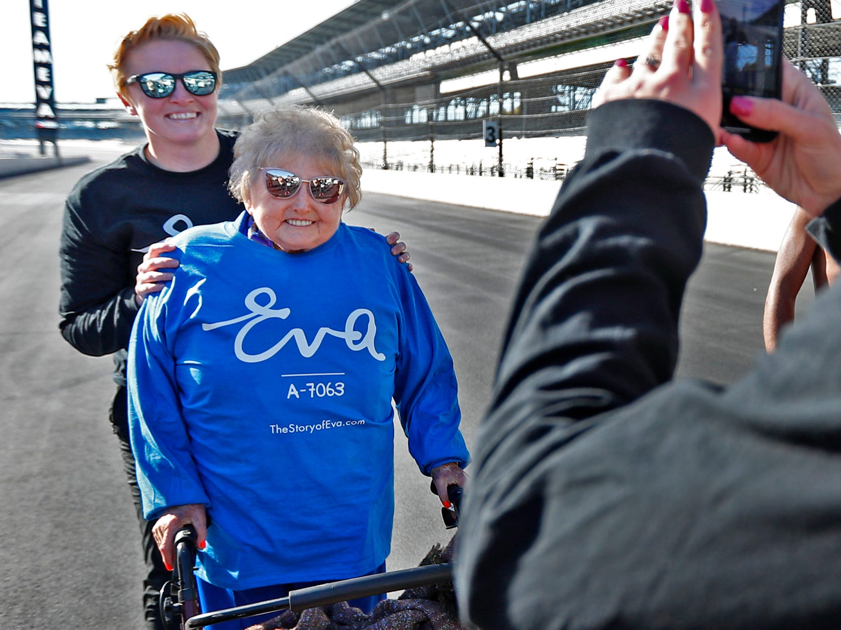 Holocaust survivor Eva Kor, right, joins others, including Mika Brown, at the Indianapolis Motor Speedway Yard of Bricks for photos, Wednesday, Oct. 24, 2018, during the pace-setting run for the 2019 OneAmerica 500 Festival Mini-Marathon.  The 500 Festival will donate $1 to the CANDLES Holocaust Museum in Terre Haute for every mini-marathon participant who finishes the 2019 race in a better time than Team Eva.  Kor ran the very last of the relay race.