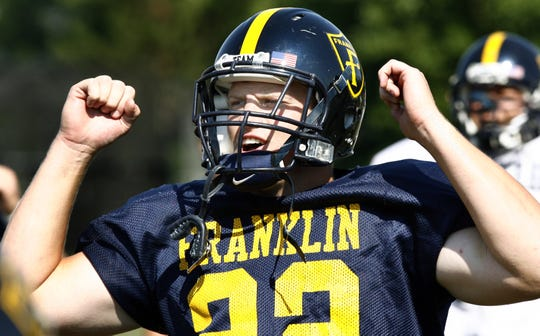 Football player Matt Taylor gets his team fired up at the start of practice. Franklin College football player and graduate of Roncalli High School Matt Taylor works out during practice with his team on Monday afternoon, August 27, 2007. Taylor is one of Franklin's football team captains.
