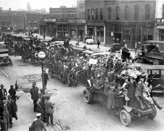 Indianapolis defense workers went wild with the news of the Armistice on Nov. 11, 1918. This scene, in the first block of Kentucky Avenue, looks south from near Washington Street.